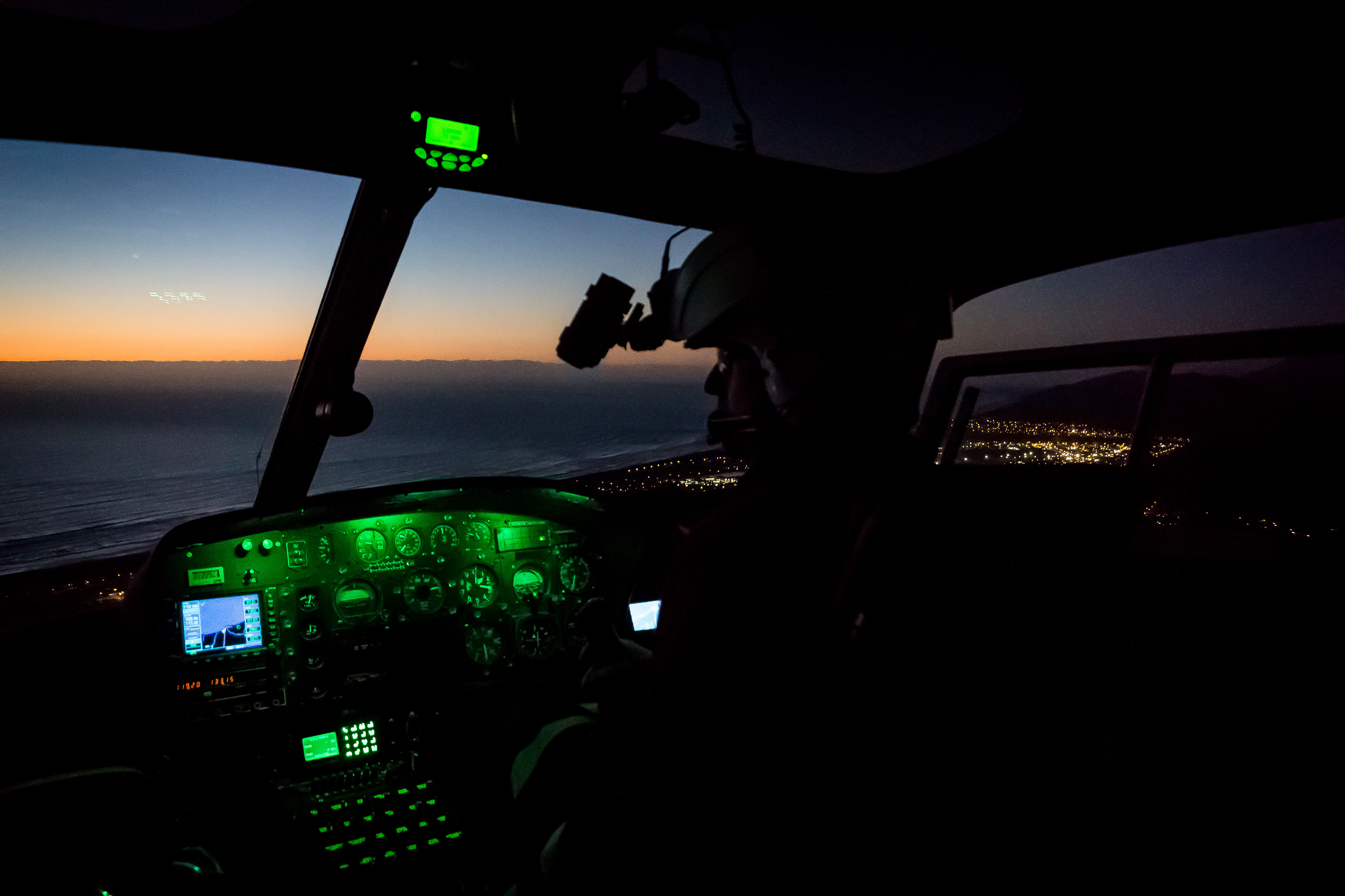 Martin Shaw at the controls of HGH returning to Greymouth from a mission to Christchurch. 16 Jun 2015