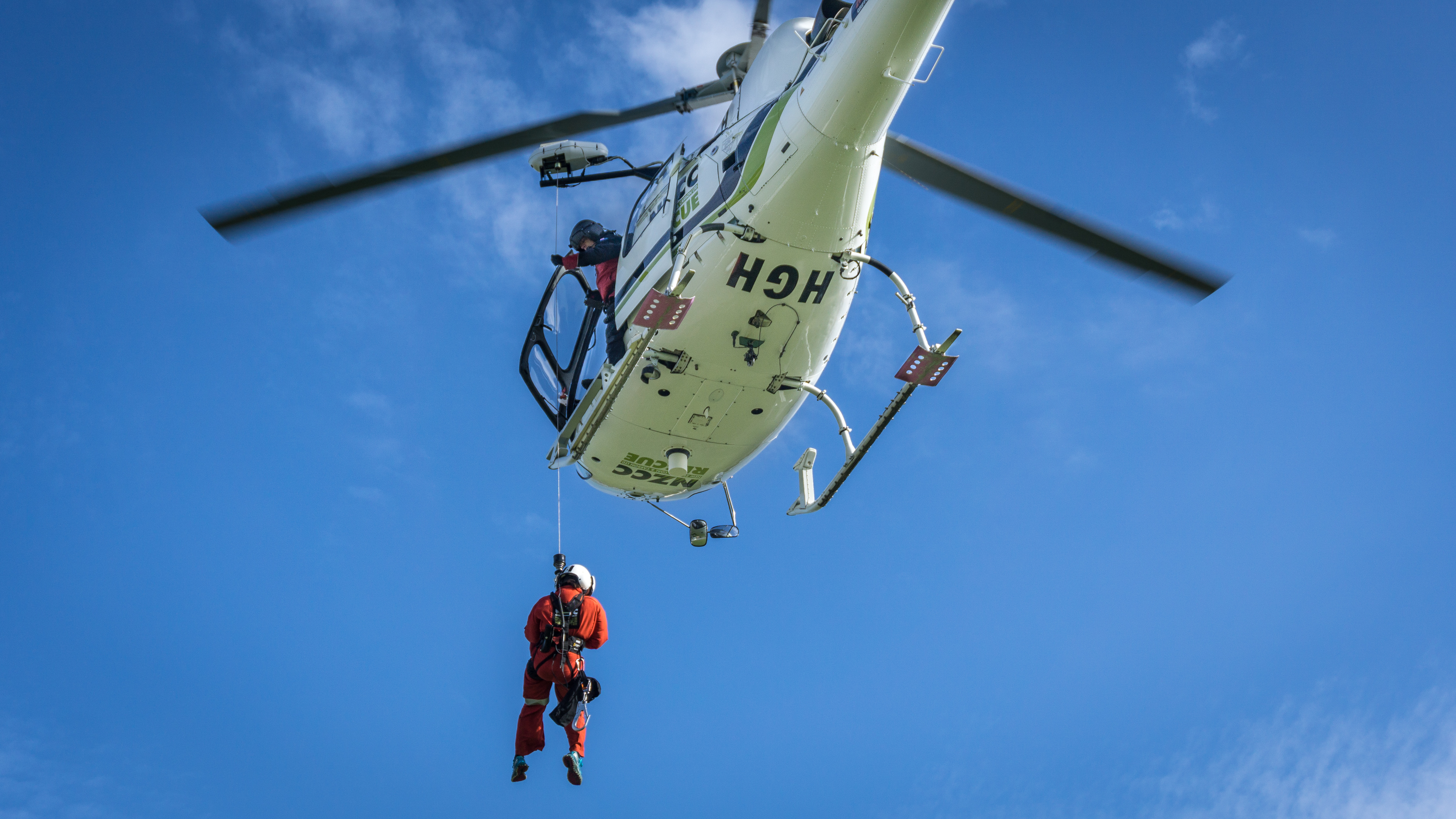 Emma Carrod  (Greymouth Police) about to be winched aboard HGH by Rob Stokes (winch op.) and Angus Taylor (pilot).  Greymouth, 26 MAy 2015
